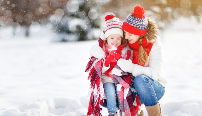 Mother and daughter in the snow