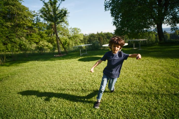 boy-running-on-grass